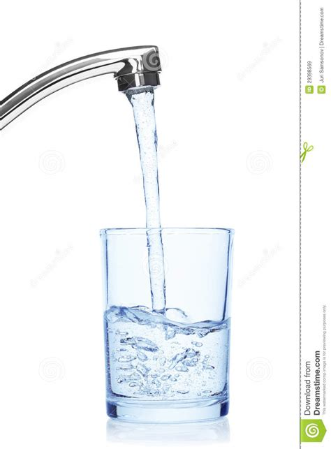kitchen sink faucet glass filled with water from tap stock image