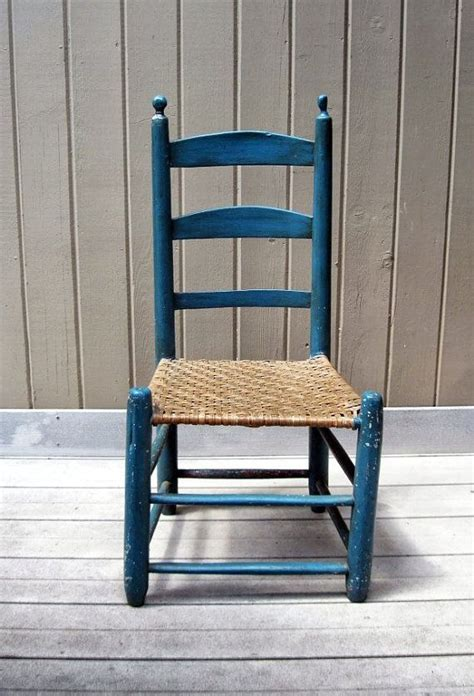 vintage primitive ladder back chair with woven seat