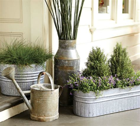 These galvanized metal wall pockets perfectly display floral and add a touch of industrial texture. Galvanized Metal Tubs, Buckets, & Pails as Planters | Driven by Decor