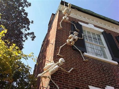 skeletons climbing house a house halloween decorations and skeletons on pinterest