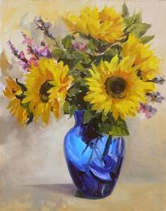 kavanaugh sunflowers in a blue vase