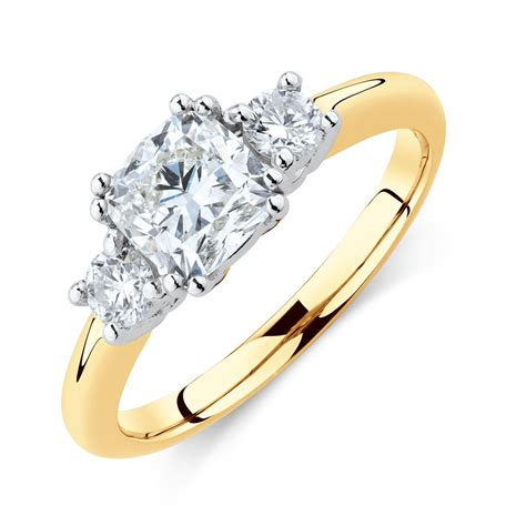 three engagement ring with 1 2 carat tw of diamonds in 14ct yellow white gold