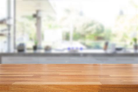 empty wooden table  blurred kitchen background  cms