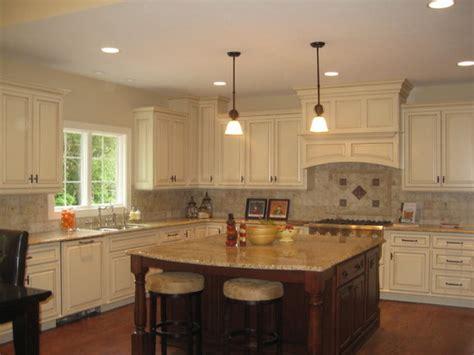 white kitchen cabinet  brown island  couple