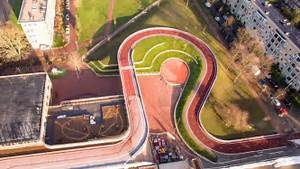 This Vivid Red Bicycle Track Winds Over The Roof Of A School In The Dutch City Of Utrecht  And