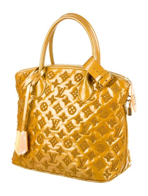 louis vuitton lockit bag handbags lou  realreal