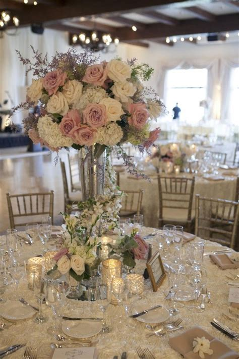 flower table decorations for weddings at the base of the centerpieces collections of mercury