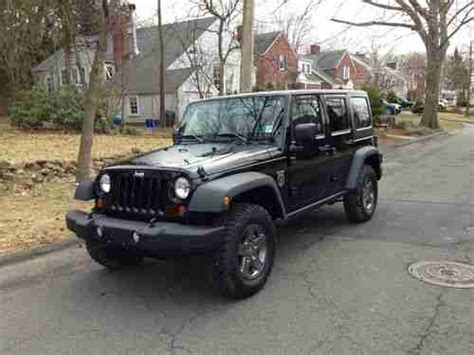 black jeep 4 door purchase used 2011 jeep wrangler 4x4 call of duty black