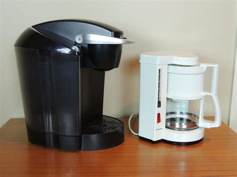 Makes hot hot coffee quickly, whether it's a pot or a cup. Keurig K40 Single Cup Coffee Brewer and Small Krups Coffee Maker | EBTH