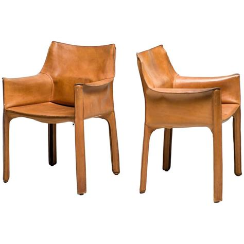 pair of mario bellini saddle leather cab chairs cassina