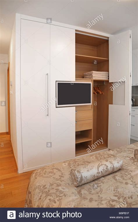 Big Wardrobe Closet by Big Wardrobe Closet With Built In Lcd Tv Stock Photo