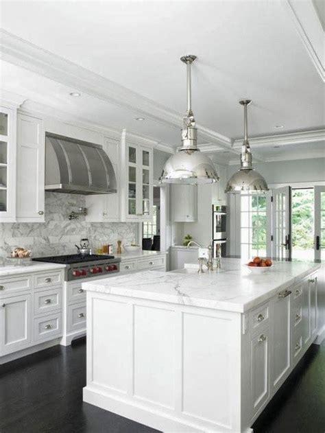white kitchen  chrome finishes  marble white