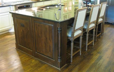 kitchen island with posts kitchen island burrows cabinets central builder