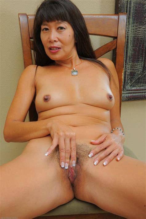 Asian Milf Sakura shows off her hairy muffin - Pichunter