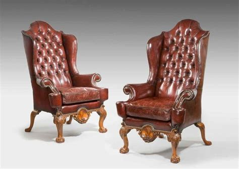 A Pair Of Oversized Walnut Wing Armchairs