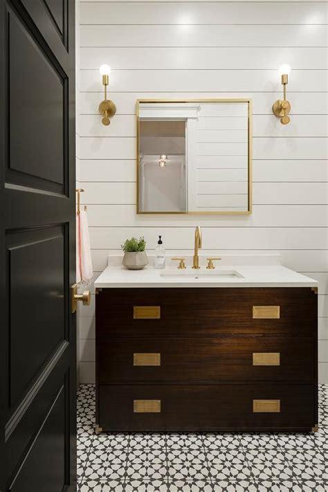 black metal curved mirror  white bath vanity