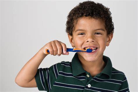child  brush  teeth