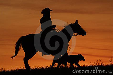 cowboy  dog silhouette royalty  stock photography