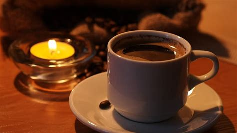 Romantic Background With A Cup Of Coffee And Candles Stock Nespresso Coffee Pods Pdf Types Brazilian Green Beans Wholesale Rio De Janeiro Dublin Factory Evoluo Cool Tables Australia