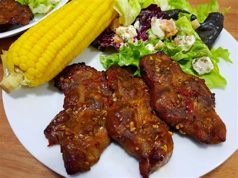 2 pieces (2 lbs / 907 g) beefsteak 4 garlic cloves 2 tbsp dijon mustard 2 tbsp olive oil. Pork Steak with Salad and Corn - Simple 45-Minute Recipe