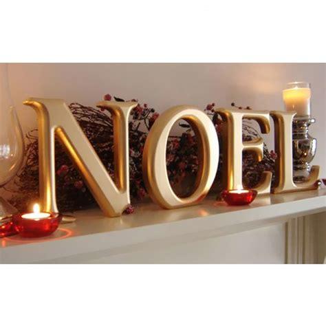 gold carved wooden noel wooden letters