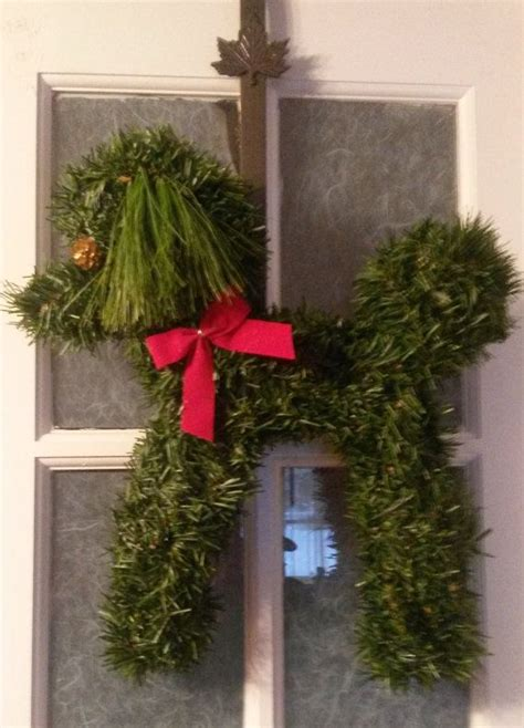 poodle wreath  green pine  red trim