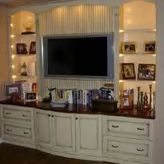 using kitchen cabinets for entertainment center turn a closet into a built in entertainment center 9575