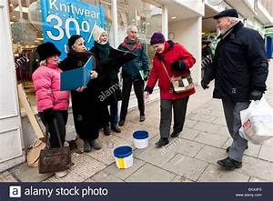Carol singers singing on the street to raise money for ...