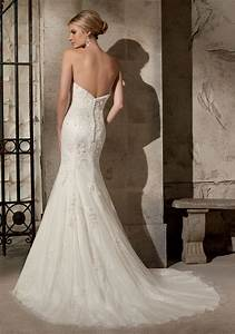 delicately beaded embroidery on net over chantilly lace With chantilly lace wedding dress