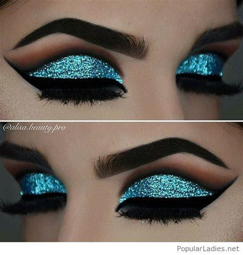 light blue cut up jeans awesome blue glitter eye makeup