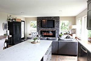 Great room with open layout, ledgestone fireplace with TV