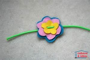 un bracelet de fleurs en feutrine cabane a idees With tapis chambre bébé avec bracelet cordon fleur
