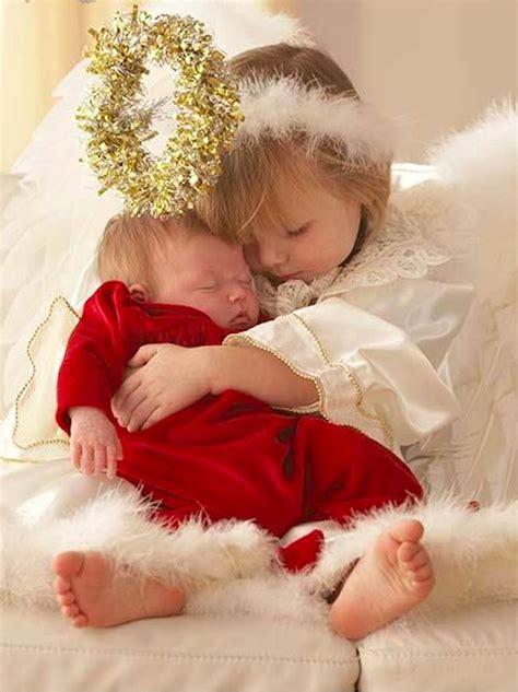 sweet  angel hugs baby sister photo ariel skelley