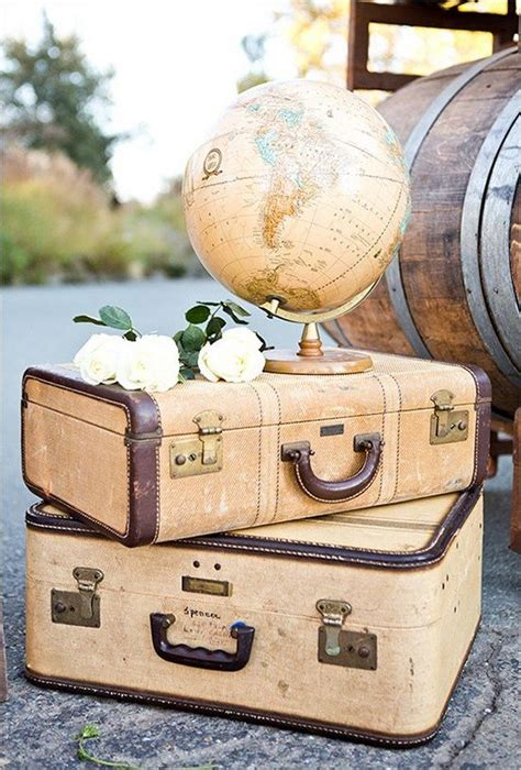 suitcases and globe vintage travel themed wedding