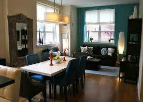 painting open dining to living room with teal blue accent