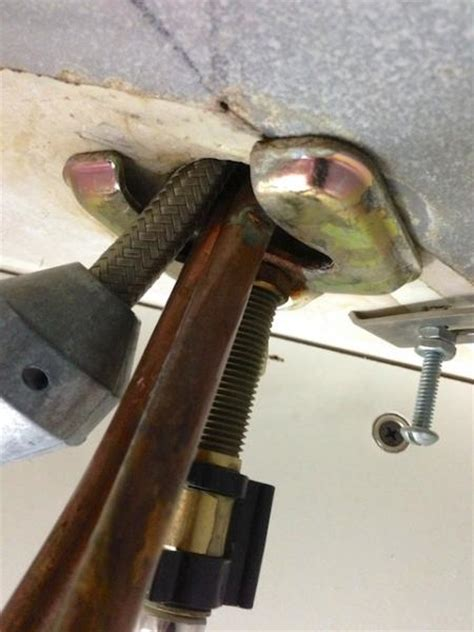 removing kitchen sink faucet can someone help me figure out how to remove this faucet