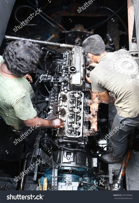 Boat Mechanic License by Mechanic Repairing A Machine In The Boat Stock Photo