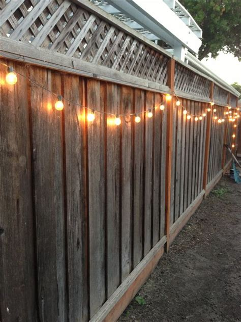 how to hang string lights on fence diy backyard lighting hang lights on your fence diy