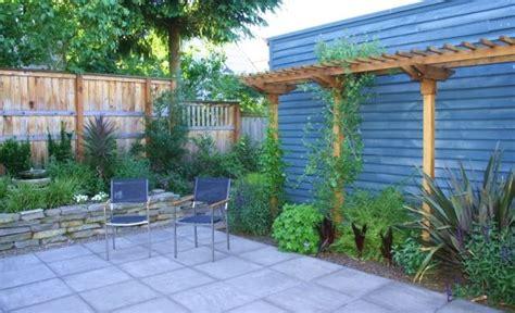 backyard idea add pergola  wall  paver pathway