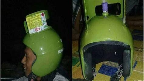 pria ubah tabung gas  kg menjadi helm