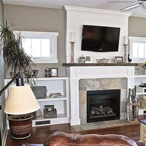 free standing cabinets next to fireplace love my fireplace built ins and ship lap wrap i 39 ve