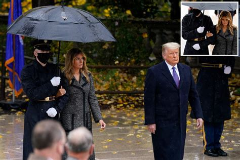 Melania Trump grips serviceman's arm and NOT Donald's at ...
