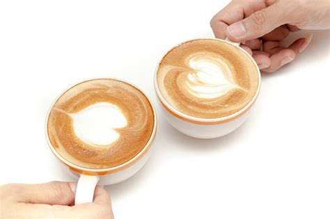 Sure, you could go ahead and make your usual cup of joe, but show off your love for coffee by learning how to make a latte topped with a beautiful foam heart. Coffee Cups Of Latte Art Heart Shape Drinking Together On White Background Isolated Stock Photo ...