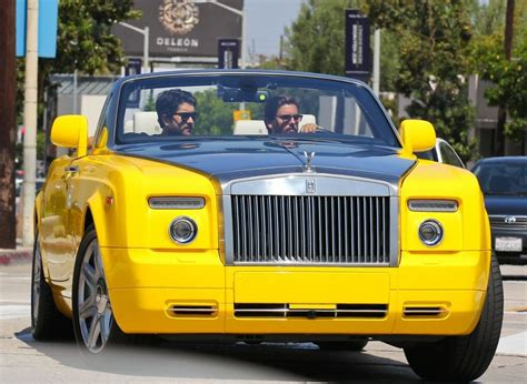 yellow rolls royce scott disick out for a ride in his yellow rolls royce