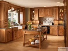 choosing kitchen cabinets kraftmaid glaze cabinets with granite countertops 2187