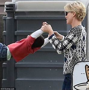 Senn Penn Gets To Grips With Charlize Theron On Family Day