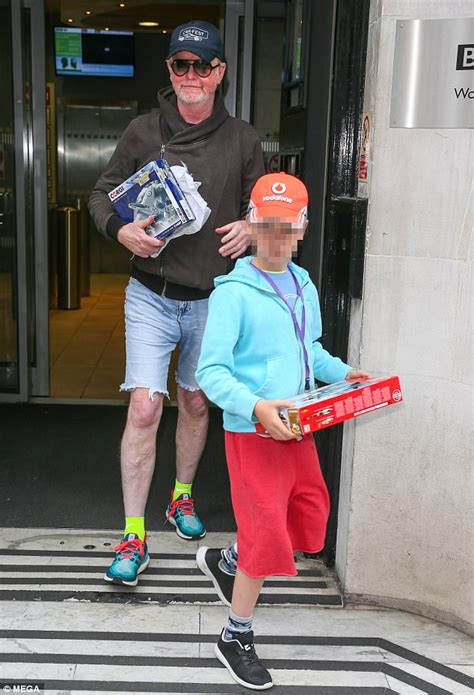 Chris Evans leaves BBC Radio 2 studios with his son Noah ...