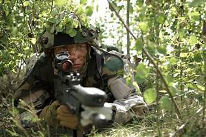 File A Latvian Soldier Waits To Conduct An Ambush During A