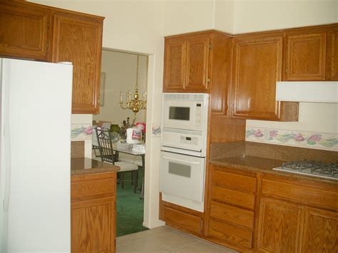 Restaining Kitchen Cabinets Before And After by Refinishing Oak Kitchen Cabinets Before And After