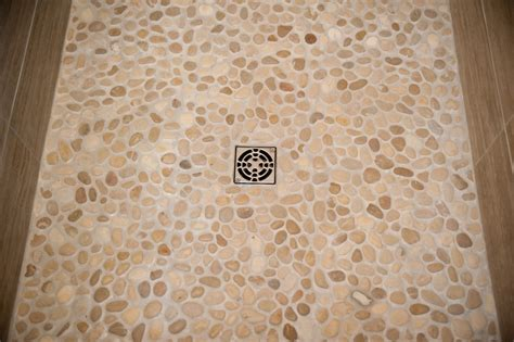 pebble rock shower floor river rock pebbles for your shower design build pros